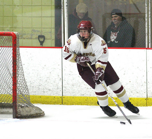 Newburyport: Newburyport defenseman Dom Ferreira (16) skates the puck out from behind his goal during Tuesday night's game against Danvers. The Clippers won the game in a shootout as part of the Newburyport Bank Tournament. Photo by Ben Laing/Staff Photo