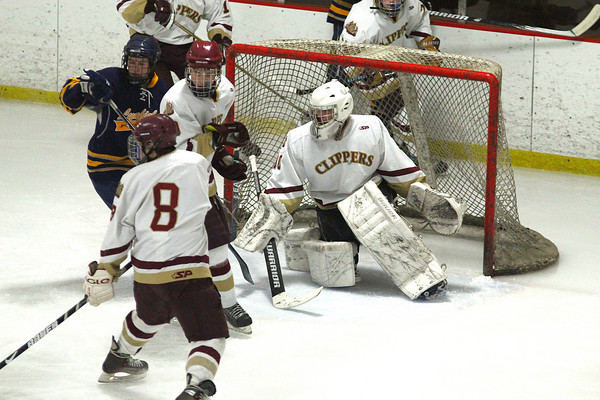 Newburyport: Newburyport goalie Alex Buckley (30) searches for the puck during Wednesday night's 1-1 tie with Lynnfield at the Graf Rink. Photo by Ben Laing/Staff Photo