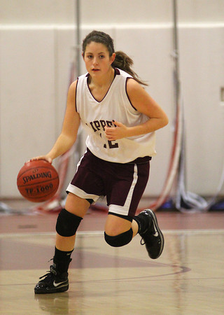 Newburyport: Newburyport's Molly Rowe (12) brings the ball up the the court during Tuesday night's game against Georgetown. Photo by Ben Laing/Staff Photo