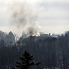 West Newbury: Smoke rises from a house fire at 21 Montclair Road in West Newbury Wednesday afternoon. Photo by Ben Laing/Staff Photo
