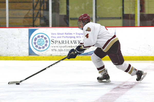 Newburyport: Newburyport's Cam Roy (4) stretches across center ice during Wednesday night's game against Franklin at the Graf Rink. Photo by Ben Laing/Staff Photo