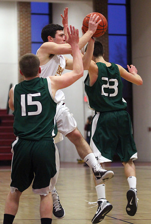 Newburyport: Will Habib (11) of Newburyport slices through two Manchester-Essex defenders and dishes the ball to a teammate during Wednesday afternoon's game at Newburyport High School. Photo by Ben Laing/Staff Photo