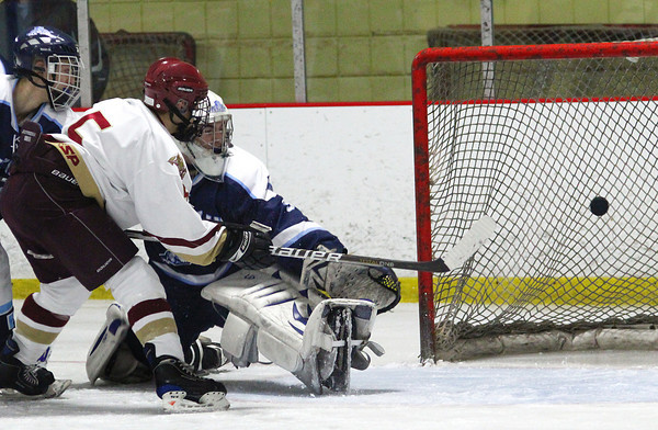 Newburyport: Tyler Janvrin (5) flips the puck past Franklin goalie Ryan Geary (3) as the Clippers hosted their Division 2 South counterparts Wednesday night at the Graf Rink. Photo by Ben Laing/Staff Photo