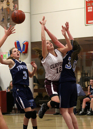 Newburyport: Newburyport's Molly Rowe (12) is fouled by Triton's Jessica Canning (30) during Tuesday night's game at Newburyport High School. Photo by Ben Laing/Staff Photo