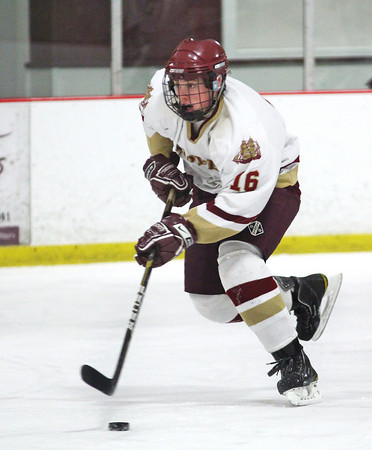 Newburyport: Dominic Ferreira (16) moves the puck up the ice for the Clippers during Wednesday night's game against Franklin at the Graf Rink. Photo by Ben Laing/Staff Photo