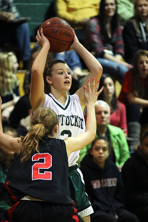 West Newbury: Pentucket's Sydney Snow (3) looks for an open teammate during Monday night's game against Watertown in West Newbury. Photo by Ben Laing/Staff Photo