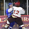 Newburyport: Newburyport's Dave Cusack (12) puts a big hit on a Danvers player duirng Tuesday nights game at the Graf Rink. Photo by Ben Laing/Staff Photo