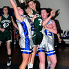 Georgetown: Pentucket's Tori Lane goes for a rebound along with Georgetown's Kylie Troy, left, and Ali Newbury, right. Bryan Eaton/Staff Photo