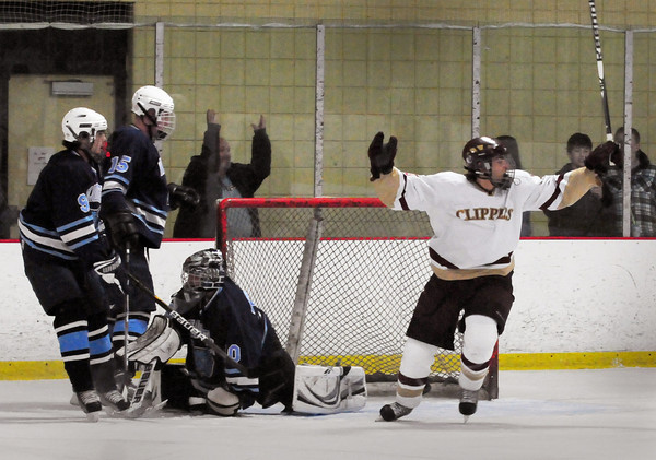 Newburyport: Newburyport's Gregory Schofield cheers a goal by teammate Kristopher Holmes on Wilmington at the Graf Rink on Saturday night. It was Newburyport's third goal in the first period. Bryan Eaton/Staff Photo