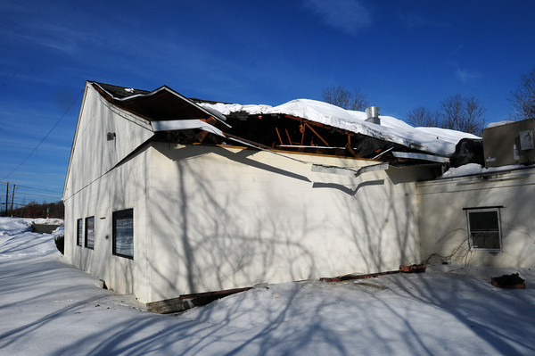 Amesbury: A section of the roof of the closed restaurant Weiloon on Route 110 collapsed yesterday afternoon. Bryan Eaton/Staff Photo