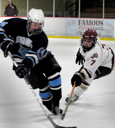 Newburyport: Newburyport's Gaven LaValley moves in on Wilmington's John Langefeld. Bryan Eaton/Staff Photo
