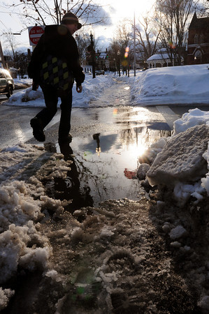 Amesbury: Melting snow has created many puddles in the area as much of the water has no place to go, like here at the entrance to the Amesbury Public Library. The puddles are going to turn into ice as temperatures get frigid again. Bryan Eaton/Staff Photo