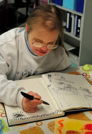 Newburyport: Emery Johnson uses ink as a medium for Opportunity Works' upcoming art show at the Newburyport Art Association. Bryan Eaton/Staff Photo