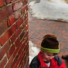 Newburyport: Some children like to jump in puddles, but Sebastian Freeman, 4, of Newburyport likes to get a shower from water coming from a downspout on State Street yesterday morning. In either case it means the snow is melting, and after a refreeze today, it will continue to melt throughout the rest of the week. Bryan Eaton/Staff Photo