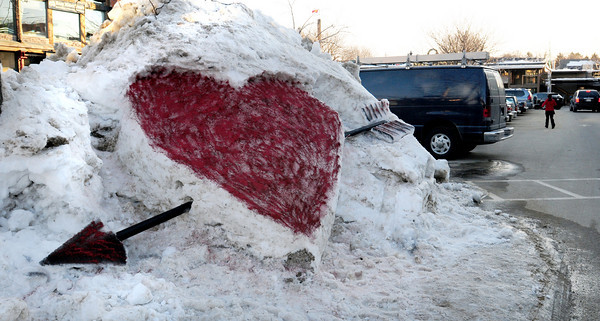 Newburyport: One Cupid-minded artist carved several of these sculptures out of snow banks in different entrances to the Tannery on Water Street in Newburyport. Bryan Eaton/Staff Photo
