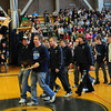 Byfield: The Triton Regional High School's Viking mascot greets the wrestling team as they walked into the gym Thursday afternoon. The school put together a short rally for the team which won the Division Three state title. Bryan Eaton/Staff Photo