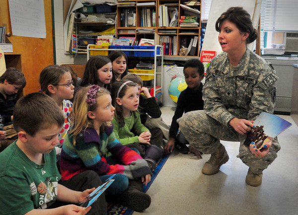 Newburyport: SPC Jillian Hoiseth, who's back visiting from an army tour in Afghanistan, talks to students of her mother, MaryEllen, at the Bresnahan School yesterday afternoon. Bryan Eaton/Staff Photo