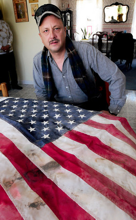 Rowley: Sgt. Robert Diehl of the US Army Reserve just returned from Logar Province in Afghanistan. The flag displayed flew on his vehicle, and after being cleaned, he wants to hang it over his Rowley home. Bryan Eaton/Staff Photo