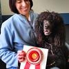 Rowley: Kim Kezer and her award-winning Irish water setter Fiona. Bryan Eaton/Staff Photo