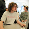 Amesbury: Mike Felix, 16, front, works on his trivia column for the Amesbury High School Weekly newspaper, while Editor-in-Chief Ethan Pratt, 17, left, checks with Alex Johnson, 16, right, and Matt Fortin, 17, hidden from view. Bryan Eaton/Staff Photo