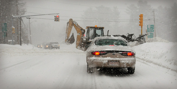 Salisbury: Snow equipment clears snow at the intersection of Route's One and 286 in Salisbury during the heaviest snowfall on Wednesday morning. Bryan Eaton/Staff Photo