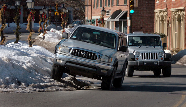Newburyport: The huge snowbanks have caused motorists to pull out slowly into intersections to look for oncoming cars and created inventive solutions to on-street parking like this Toyota on Water Street in Newburyport. Bryan Eaton/Staff Photo