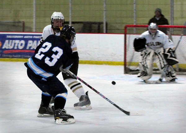 Newburyport: Triton's Schyler Reilly makes a shot on the Haverhill net coming up short of a goal. Bryan Eaton/Staff Photo