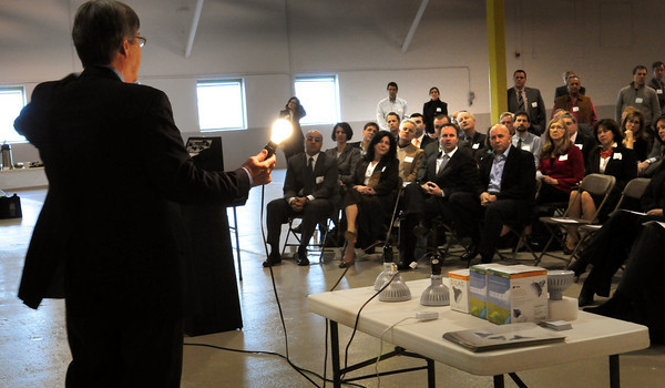 Newburyport: Steve Johnson, Ph.D. and Chief Technical Officer of Solais LED and Lighting shows off an incandescent light bulb with 110 year-old technology before showing off his company's led lamps, with 10 year-old technology to local elected officials and business leaders at new Clean-Tech center in Newburyport's industrial park. Bryan Eaton/Staff Photo
