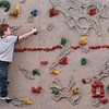 Amesbury: Kindergartner Carson Scarinci, 5, plans out his next move on the rock wall, though he's only two feet up, at Amesbury Elementary School on Thursday morning. He was in Margaret Welch's physical education class where children could choose their activities for the class. Bryan Eaton/Staff Photo