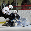Newburyport: Triton goalie Carl Orlandi stops a shot by Haverhill's Jeffrey Roberts last night at the Graf Rink. Bryan Eaton/Staff Photo