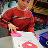 Salisbury: Devin McLellan, 5, decorates his Valentine's Box in Jane Keeler's kindergarten class at Salisbury Elementary School on Wednesday morning. The boxes will be to take home Valentine's cards and treats from the upcoming party. Bryan Eaton/Staff Photo