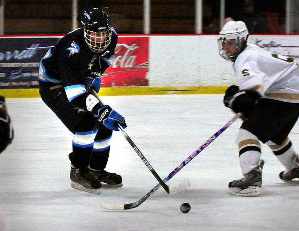 Newburyport: Triton's Cam D'Agostino moves the puck past a Haverhill player last night at the Graf Rink. Bryan Eaton/Staff Photo