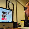 Amesbury: Photographer Jason Grissino, 16, edits photos of the boys basketball game against Rockport for the upcoming edition of the Amesbury High School Weekly newspaper. Bryan Eaton/Staff Photo