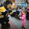 "Newbury: Boston Bruins Mascot ""Blades"" hands Mackie Hughey, 2, of Newbury a silly band during a special Pajamas Story Hour as part of the Fourth Annual PJ Drive. The library is one of several in the state partnering with the Boston Bruins to collect new pajamas for underprivileged children. Bryan Eaton/Staff Photo"