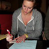 Newburyport: Daily News reporter Alex Marciello writes down an answer at Trivia Night at the Port Tavern. Bryan Eaton/Staff Photo
