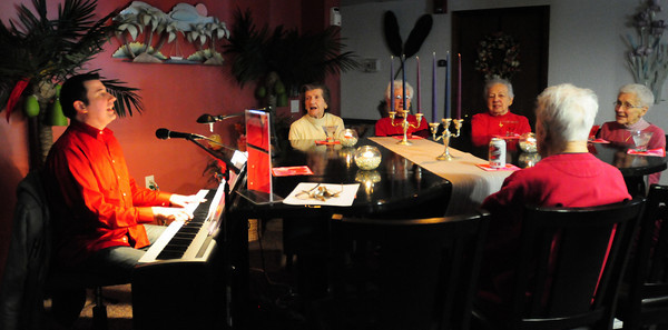 Salisbury: Robert Dionne plays the classics at a Valentine's Day Cabaret at the Salisbury Assisted Living Center on Monday afternoon following a candlelit lunch. Bryan Eaton/Staff Photo