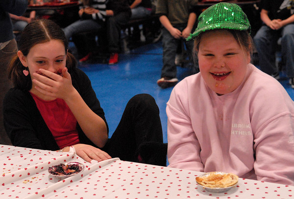 Seabrook; Brooke Walsh (left) and Megan Smith, students at Seabrook Elementary School, participated in a pie eating contest in the cafeteria on Monday morning. It's carnival week at Seabrook, and each day different events are held during lunch time. Staff Photo/Mary O'Connor
