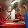 Newburyport; Students in a kindergarten class at Seabrook Elementary school peer into the class valentine box on Monday morning. Mary O'Connor/Staff Photo