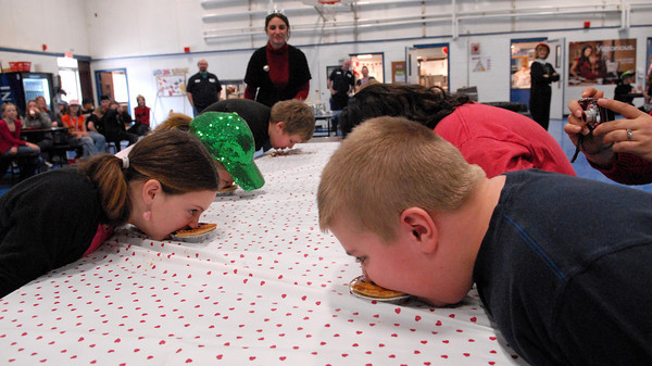 Seabrook; Students at Seabrook Elementary School participate in a pie eating contest in the cafeteria on Monday morning. It's carnival week at Seabrook, and each day different events are featured during lunch time. Mary O'Connor/Staff Photo