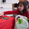 Seabrook; Caroline Tavolieri, a kindergartener at Seabrook Elementary School, puts candy hearts into the class valentine box on Monday morning. Mary O'Connor/Staff Photo