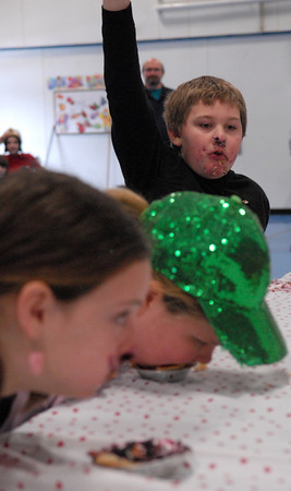 Seabrook; Ryan Wilson, a 10-year-old student at Seabrook Elementary School, wins a pie eating contest in the cafeteria. It's carnival week at Seabrook, and each day different events are featured during lunch time. Mary O'Connor/Staff Photo