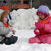 Newburyport; Ivy (left) and Tyler, play in the snow outside Newburyport Montessori School on Monday afternoon. Mary O'Connor/Staff Photo