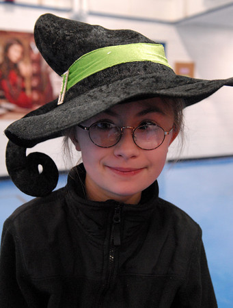 Seabrook; Paige O'Brien, an 11-year-old student at Seabrook Elementary School, wears a witch hat for crazy hat day. It's carnival week at Seabrook, and each day a different theme is featured. Mary O'Connor/Staff Photo