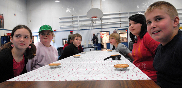 Seabrook; Students at Seabrook Elementary School listen to the rules for their pie eating contest in the cafeteria Monday morning. It's carnival week at Seabrook, and each day different events are featured during lunch time. Mary O'Connor/Staff Photo