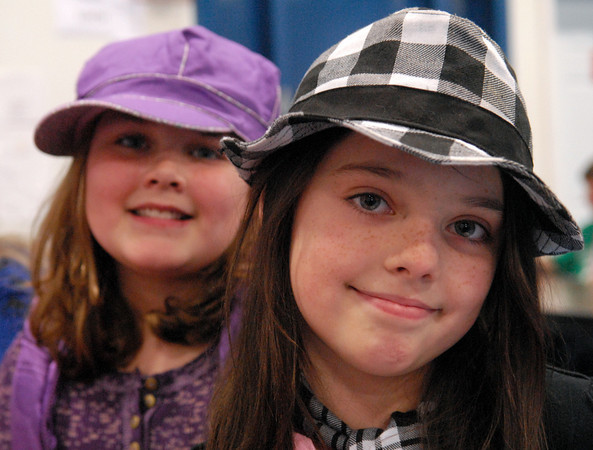 Seabrook; Hannah Hale (left), and Emily Donahue, 10-year-old students at Seabrook Elementary School, wear hats for crazy hat day. It's carnival week at Seabrook, and each day a different theme is featured. Mary O'Connor/Staff Photo