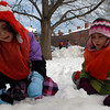 Newburyport; Five-year-olds Rose (left) and Helen play outside of the Newburyport Montessori School on Monday afternoon. Mary O'Connor/Staff Photo