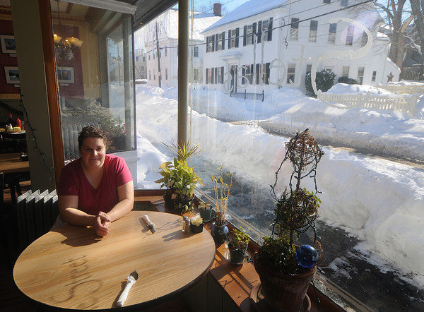 Newburyport: Owner Jean Nicoletti Butler sit in the window at Stella's on Middle Street in Newburyport, the resent snow has made it difficult for costumers to get to her restaurant. Jim Vaiknoras/Staff photo
