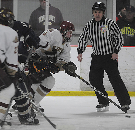 Newburyport: Newburyport's Connor Wile  clears the puck against St Mary's during their game in the final of the Newburyport Bank 16th Annual Hockey Tournament. JIm Vaiknoras/Staff photo