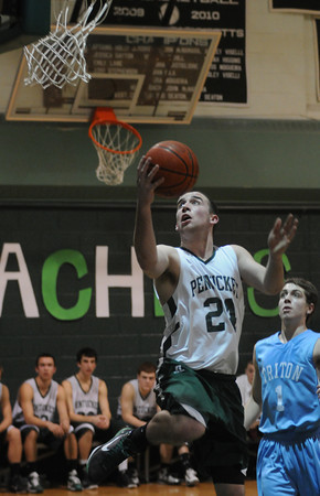 West Newbury:Pentucket's Calvin Wiles glides to the hoop for two during the Sachem's game against Triton Thursday night. Jim Vaiknoras/Staff photo