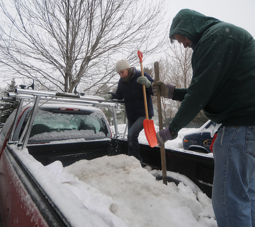 Newburyport: Archeologist Caitlin Shaffer  helps Tom Kolterjahn remove snow from a piece of a pier which was dug up in Newburyport. The artifact is being transported to Maryland for restoration. Jim Vaiknoras/Staff photo